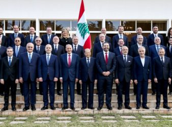 The newly-formed Lebanese Cabinet pose with President Michel Aoun.