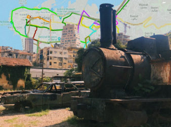 Disused train and car against a Beirut map backdrop (By Cynthia Nahhas)