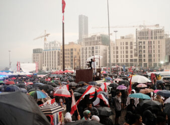 Protests in Beirut, with demonstrators demanding their rights while it rains (Eva Mahfouz)