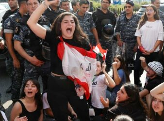 A university student gestures during an anti-government protest in Beirut. (Goran Tomasevic | Reuters)