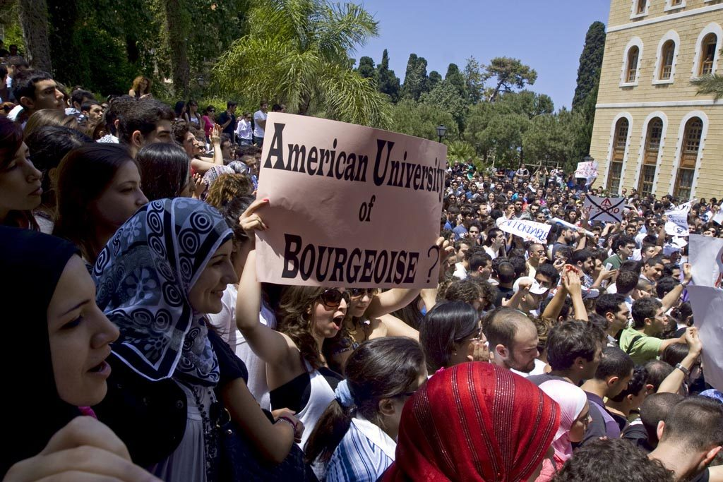 "Protester carrying an ""American University of Bourgeoisie?"" sign from 2010 at the American University of Beirut. (Farfahinne.blogspot.com)"