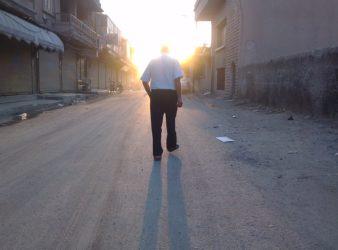 Man walking in Raqqah | August 2012. (Beshr Abdulhadi)