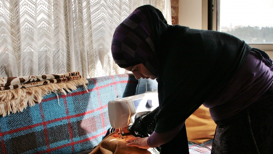 Hiba Bekai, one of the Syrian refugees in Lebanon, sews and does needlework that she sells to Syrians and Lebanese. (Venetia Rainey)