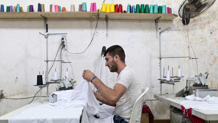 Syrian refugee in Lebanon learns how to tailor clothes. (International Rescue Committee | Jacob Russell)