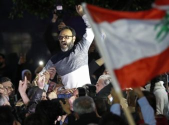 Lebanese actor Ziad Itani being carried after his release in 2018. (AP Photo   Hussein Malla)