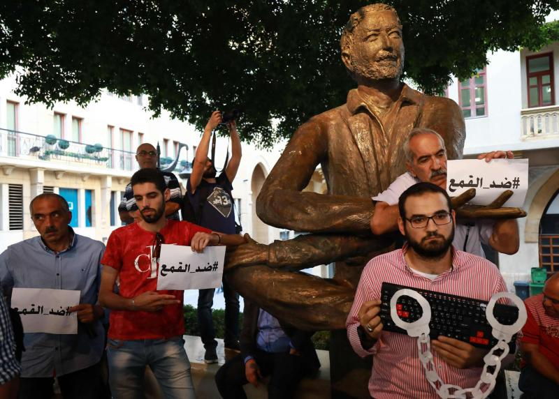 Activists in downtown Beirut protesting against the interrogation of individuals making political comments on social media. (The Arab Weekly | AFP)