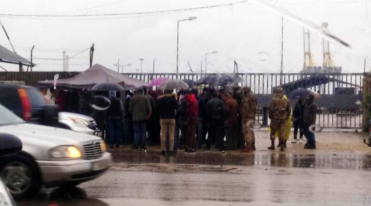 Protesters gather outside the port of Tripoli on Thursday, January 2. (NNA) Ports article