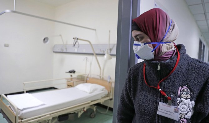 An employee wearing a protective mask near the ward where the first coronavirus case in Lebanon is being treated, at the Rafik Hariri University Hospital. (AFP / Arab News)