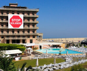 """A giant """"Stop Solidere"""" sign drapes over the St. Georges Hotel for all to see. (Allan Leonard)"""