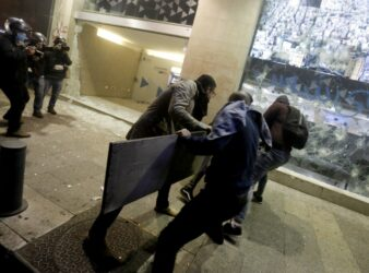 Anti-government protesters break the window of a bank in Beirut. January 2020. (Marwan Tahtah / AFP / Asia Times)