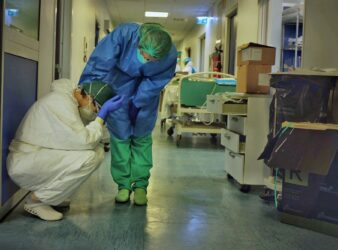 Two intensive care professionals comfort each other in the ICU of a hospital in Cremona, Italy , on Friday, March 13, 2020. (Photo: Paolo Miranda / NBC News) - Italian doctors article