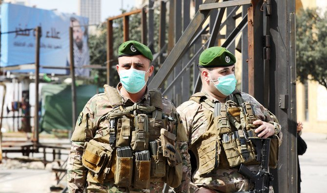 Lebanese soldiers standing guard in the Beirut's downtown district on March 15.(Arab News via AFP) Medical emergency article