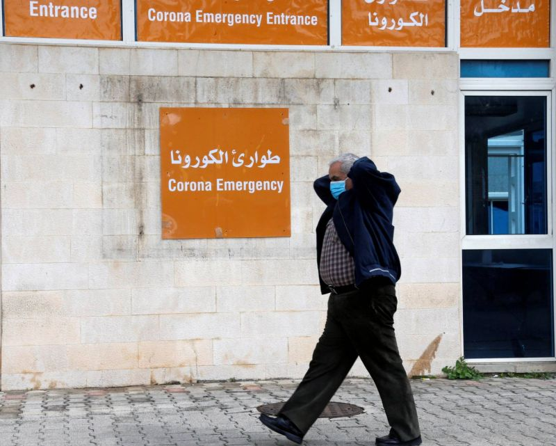 A man wears a protective mask as he walks past the coronavirus emergency department at the Rafic Hariri government hospital in Beirut, March 10, 2020. (Mohamed Azakir / Reuters / L'Orient Le Jour)