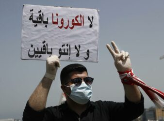 """Neither coronavirus nor you will last,"" reads this sign from a protester in Lebanon on April 24. (Photo: Lebanon Express via Hussein Malla / Ap) Lira plummet article"