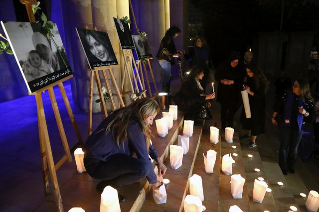 Lebanese women hold candle-lit vigil in tribute to four murdered women in Beirut, Lebanon, December 23 2017. REUTERS/Isam Abdallah