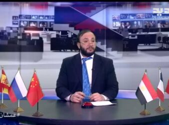 Wissam Saad sits at his desk in his persona at Al Jadeed