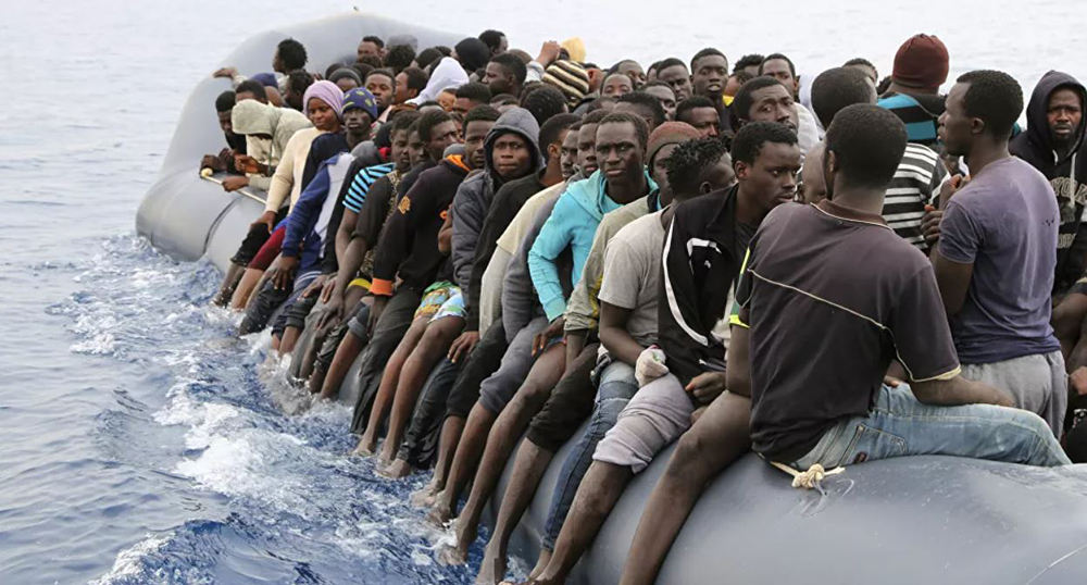 (PHOTO: Sputnik News via AFP / Abdullah Elgamoud) migrants and migration in Europe article