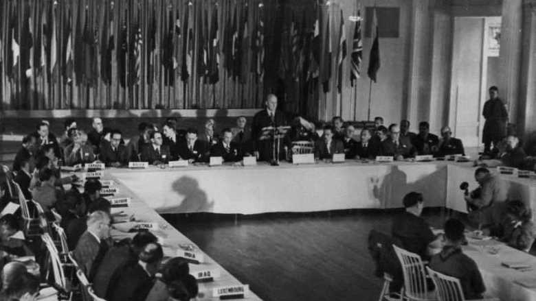 The U.S. Secretary of the Treasury, Henry Morgenthau, Jr., addresses the delegates to the Bretton Woods Monetary Conference, July 8, 1944 (Credit: U.S. Office of War Information in the National Archives).