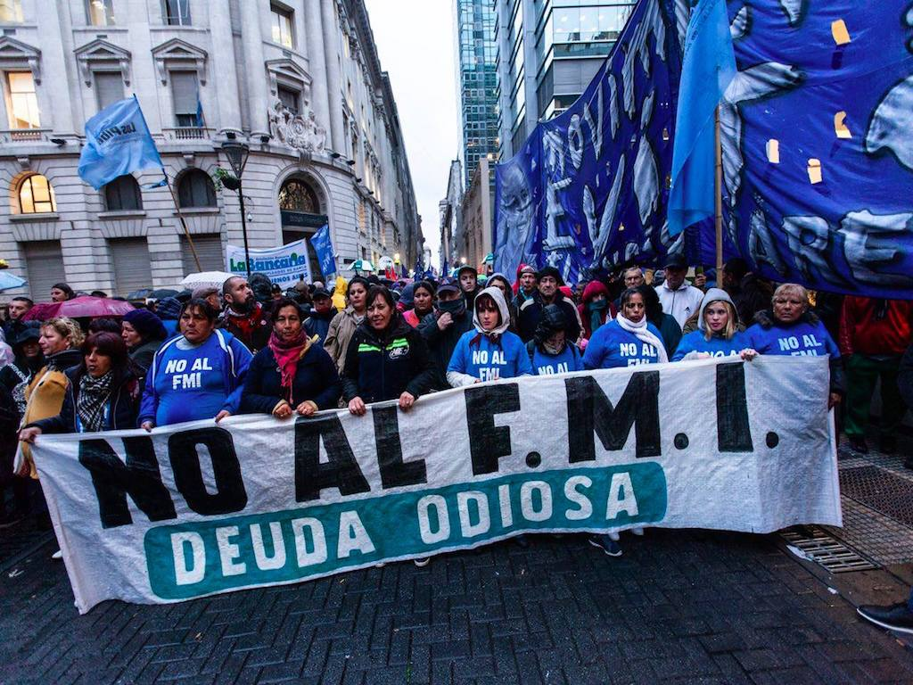 "Protesters in Argentina holding a banner that reads ""No to IMF. Hateful debt."" (Photo: Emergentes)"