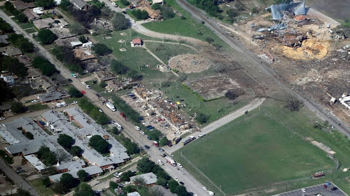 Kansas City Star - This April 18, 2013 aerial file photo, shows the remains of a nursing home, left, apartment complex, center, and fertilizer plant, right, destroyed by an explosion at a fertilizer plant in West, Texas.