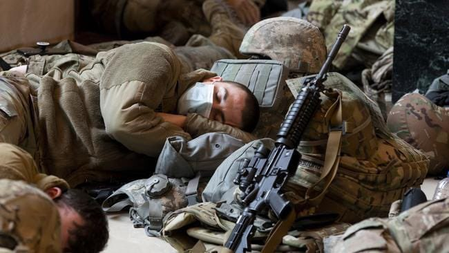 Members of the National Guard rest in the Capitol Visitors Center. (Michael Reynolds/EPA-EFE/Shutterstock)