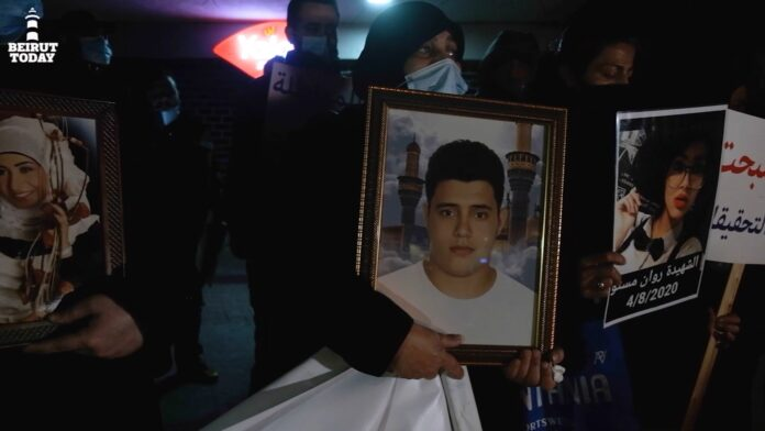 Families of victims of the Beirut port explosion clutch photos of their deceased loved ones as they protest the removal of Judge Sawan from the investigation on February 18, 2021. | Photo: Ghassan Mogharbel. Rage and anger article.
