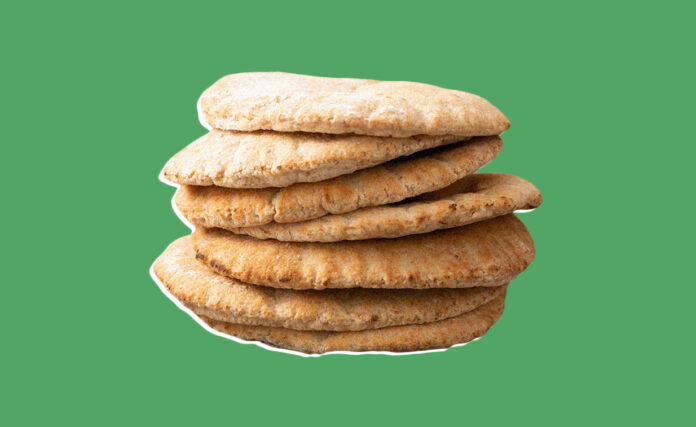 Stack of pita bread superimposed against a green background