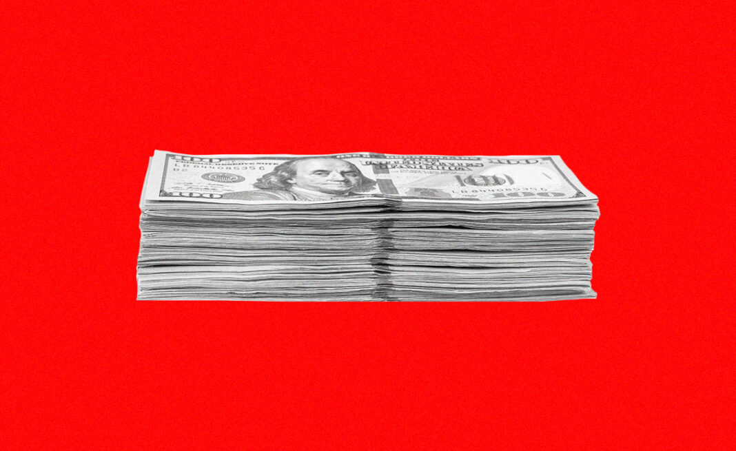 Stack of dollars against a red background