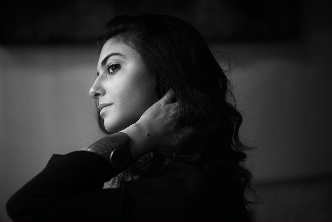 Headshot of Mounia Akl in black and white