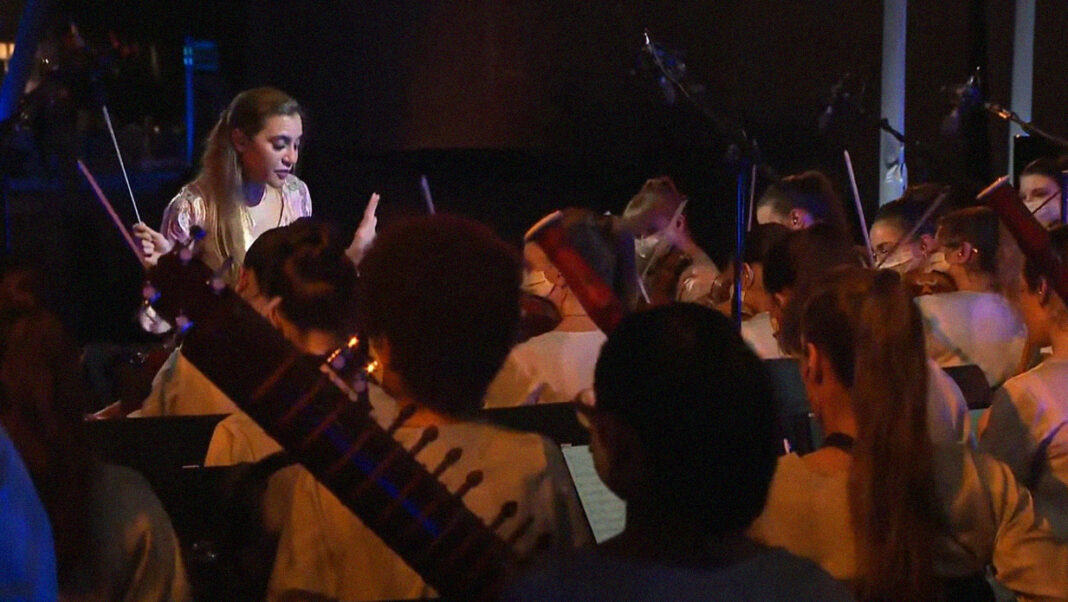 Lebanese conductor Yasmina Sabbah leads the Firdaus Women's Orchestra at the Expo 2020 opening ceremony.